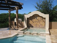 scroll work mosaic on back of pool.. niche mosaic