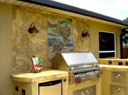 Outdoor turtle mosaic wall mural  behind outdoor kitchen backsplash