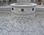 Scroll work mosaic on pool