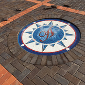 Monogrammed compass rose in driveway ...mosaic installation