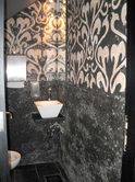black and white scroll work mosaic installation for the bathroom walls