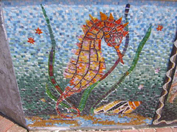 closeup of glass sea horse mosaic