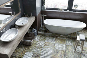 Bathroom floor installation using the spiral square mosaics