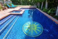 sun medallion  mosaic at bottom of pool