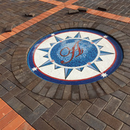 Monogrammed compass rose mosaic installation