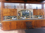 Outdoor kitchen  tuscan mosaic mural installation