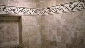 Scroll work border mosaic bathroom installation