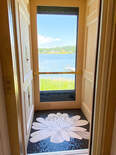 Dramatic white lotus flower mosaic entryway floor