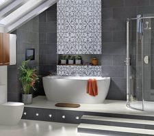 Patterned wall mosaic installation in bathroom